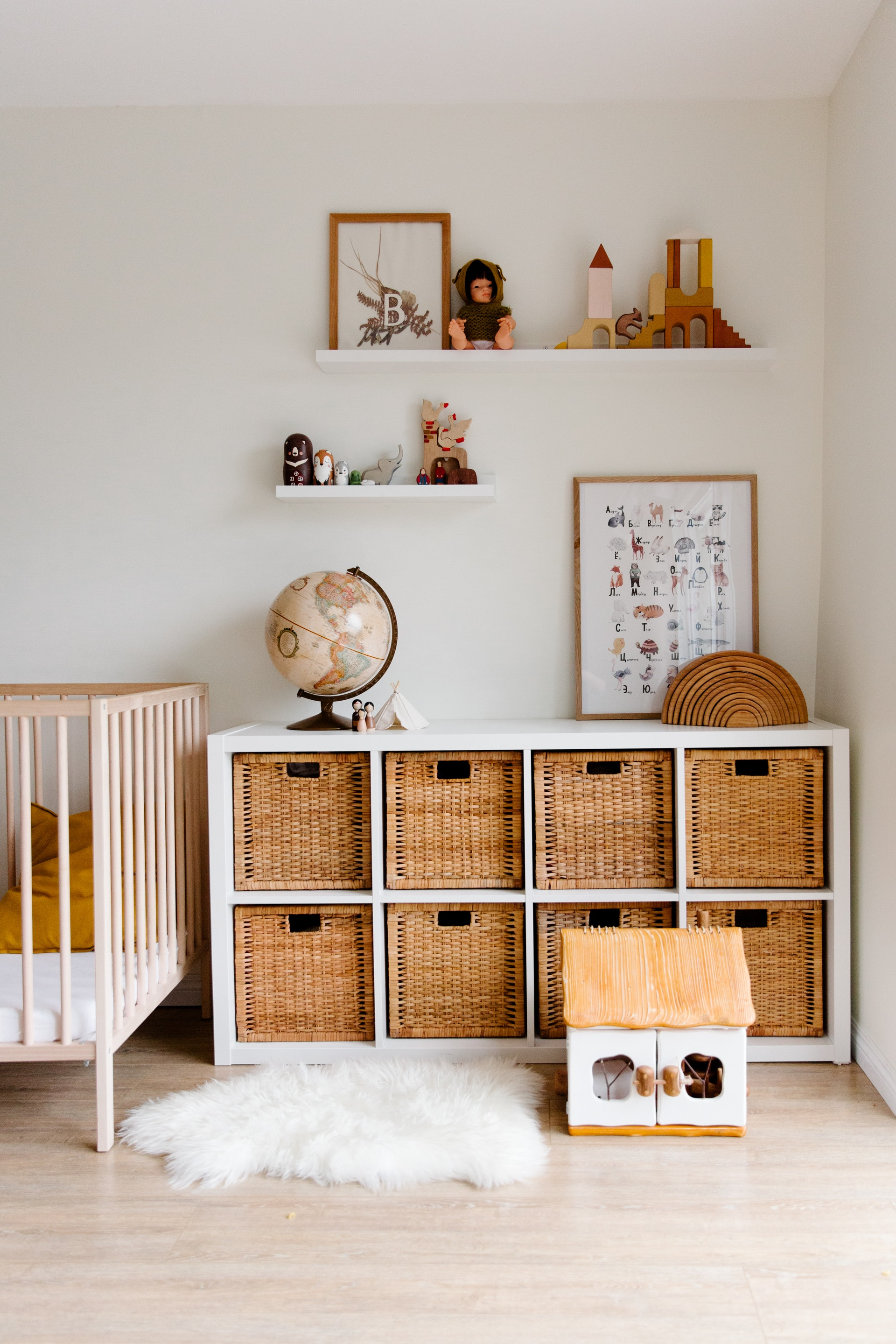 Photo of bright baby room with earthy tones.
