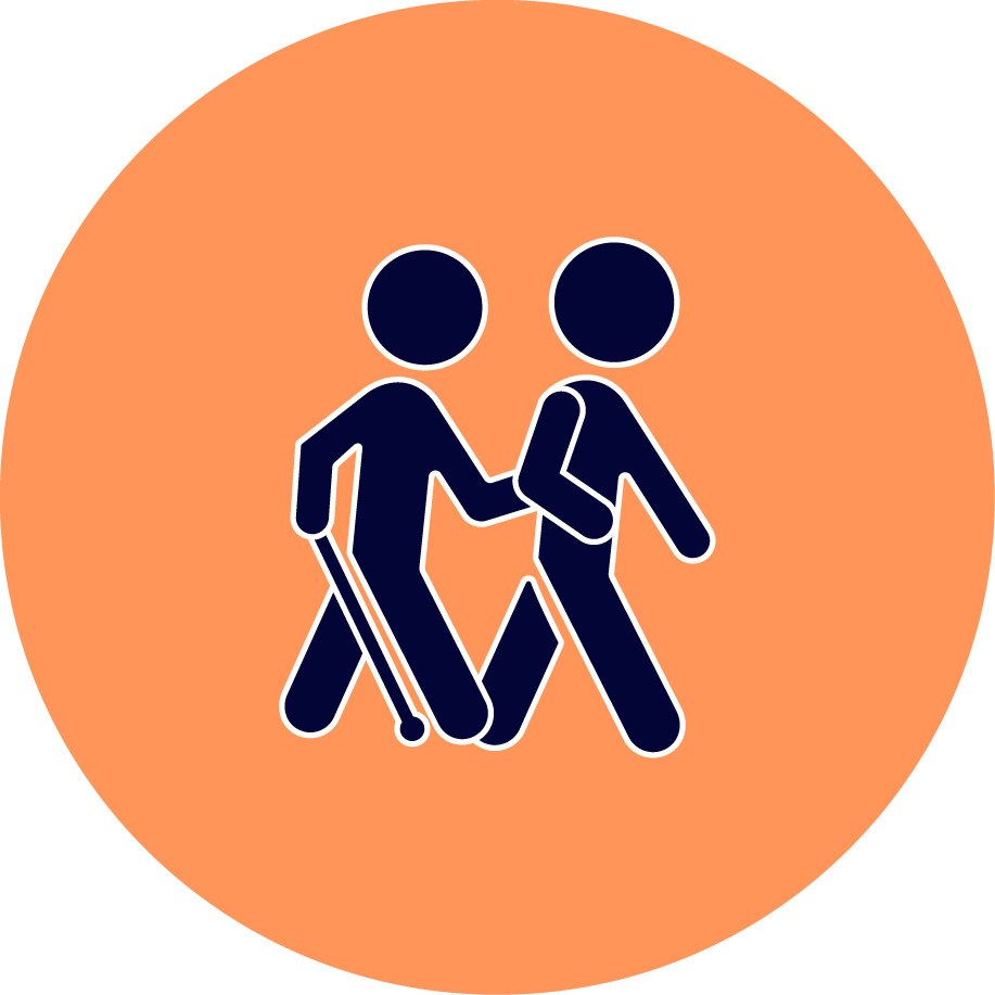 A visually impaired person walking with volunteer