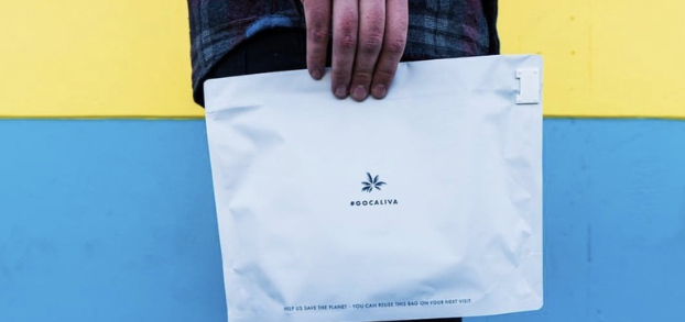 hand holding satchel with gocaliva cannabis logo