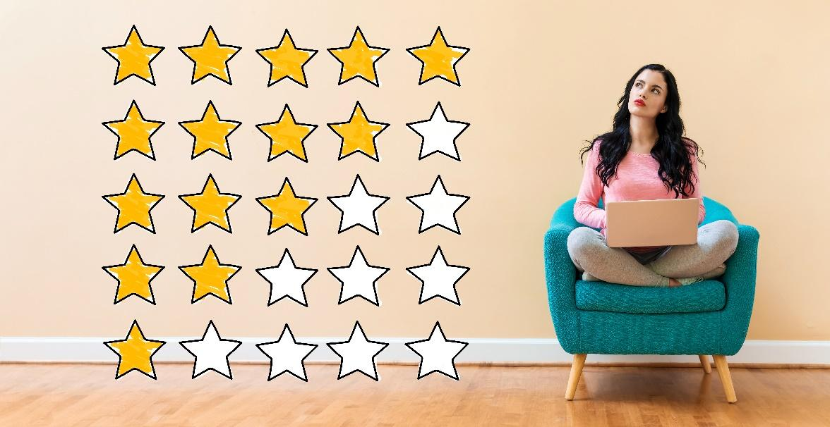 Woman sitting on a chair next to variations of 1-5 star ratings
