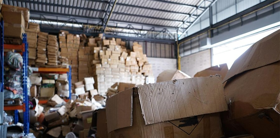 Stacks of cardboard boxes piled on shelves in a warehouse