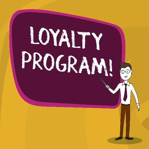 illustration of a man in a button-down shirt and tie pointing to a chalk-drawn phrase: 'loyalty program!'