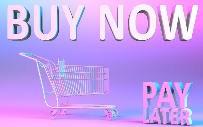 3d graphic of a shopping cart on a purple backgroun. above are the words 'buy now' and next to it are the words 'pay later'.