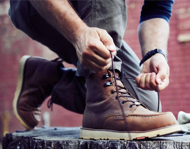 Person tying the laces on their brunt workwear boots