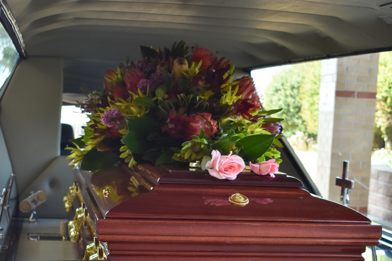 coffin with flowers at Castle funerals
