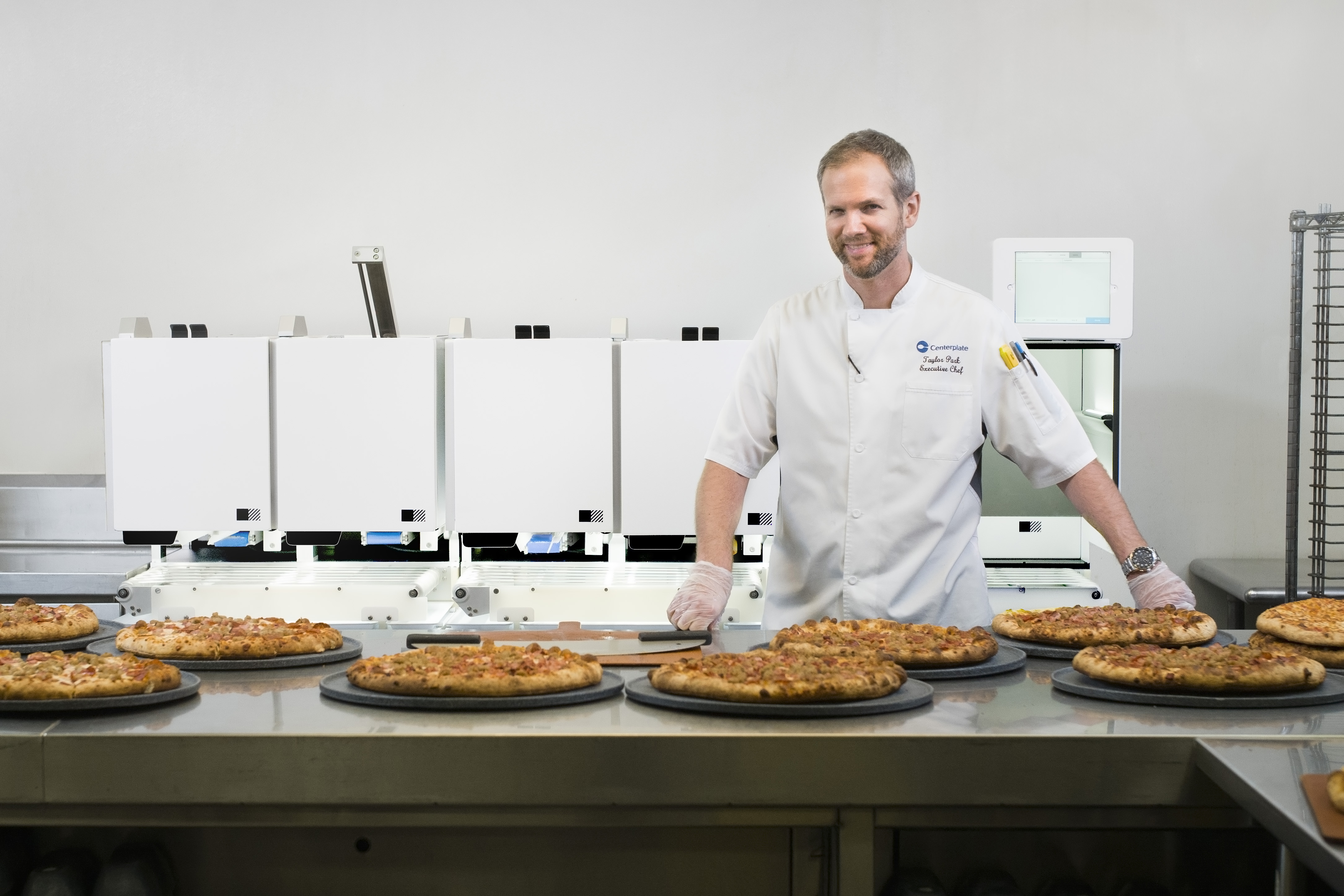 Executive Chef Taylor at T-Mobile Park in front of the first generation Picnic Pizza System