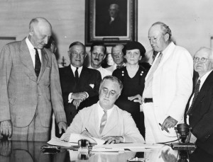 President Roosevelt signs Social Security Act into law August 14, 1935