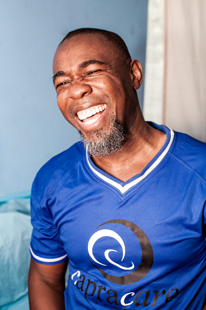 The founder of capracare wearing his capracare blue shirt while laughing.