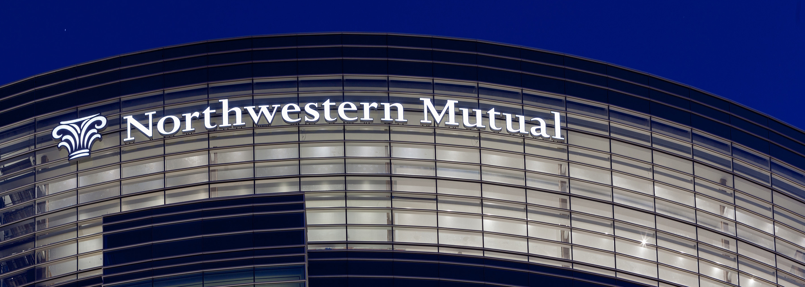 Cropped view of the Northwestern Mutual logo on the side of a skyscraper.