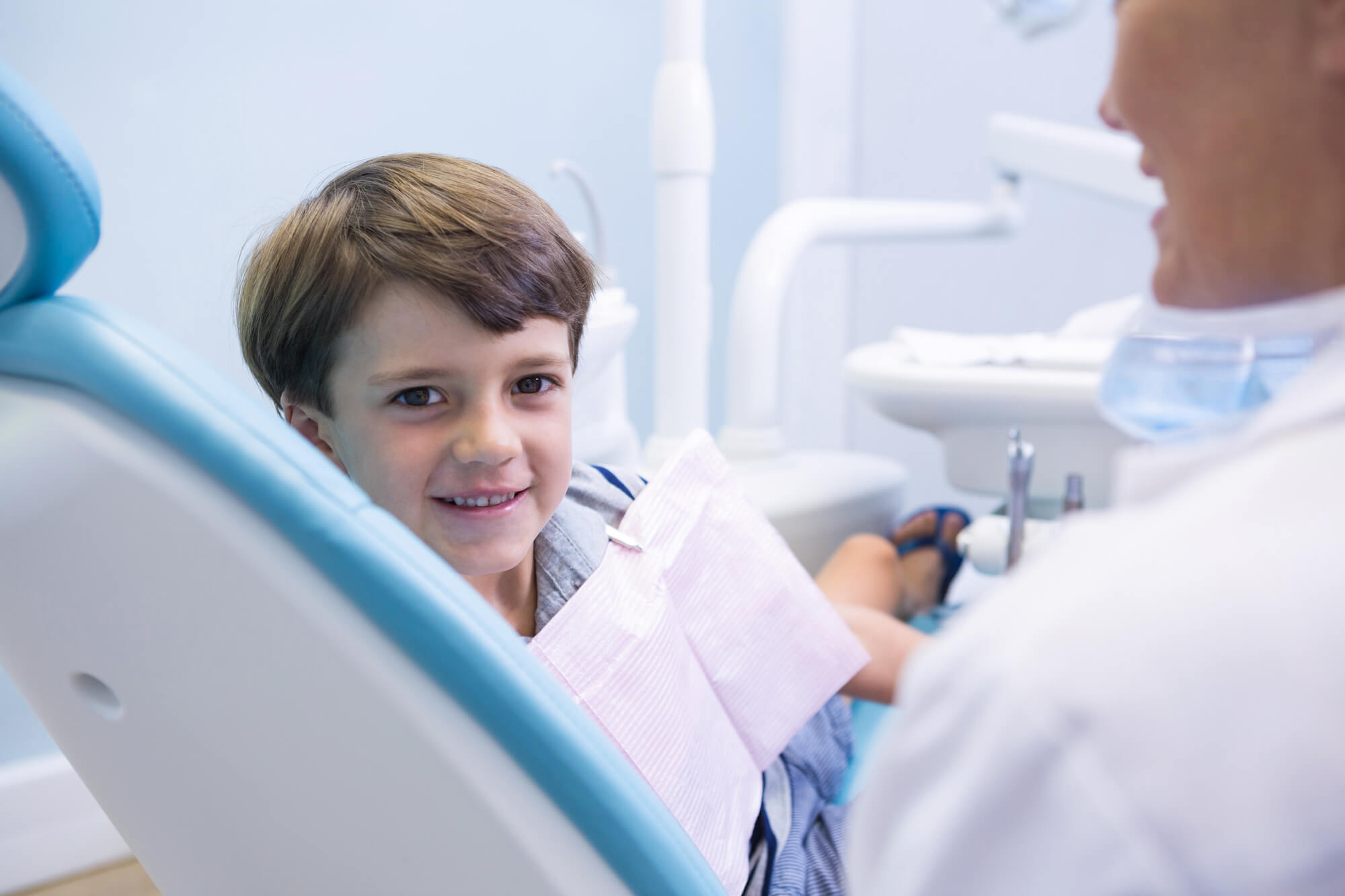 Young Boy Smiling in Dentist Chait