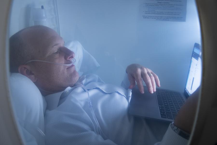 Man in hyperbaric chamber