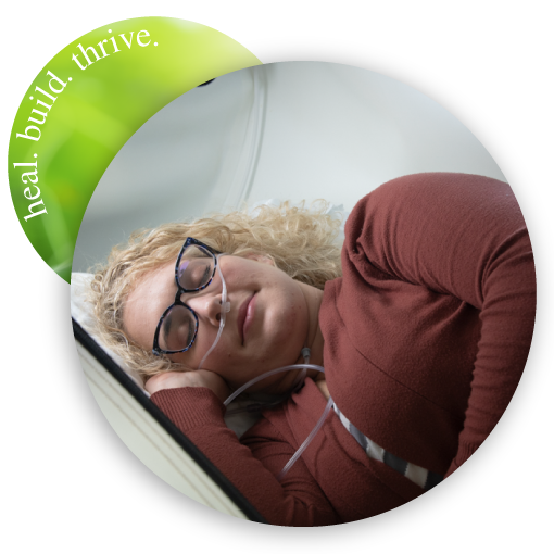 woman sleeping in hyperbaric chamber