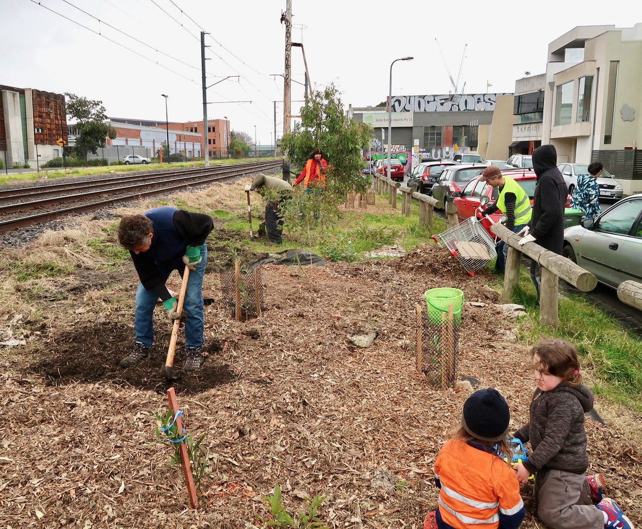 Some volunteers planting trees near Jewell Station