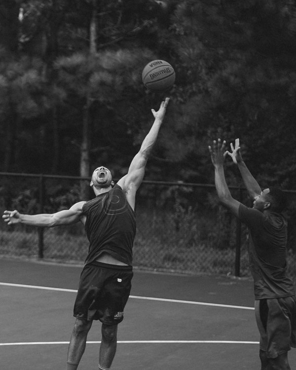 Athlete reaching for a basketball