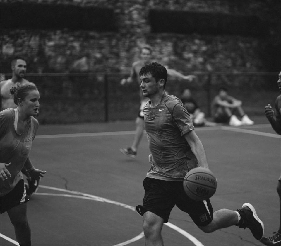 Athlete running while dribbling basketball