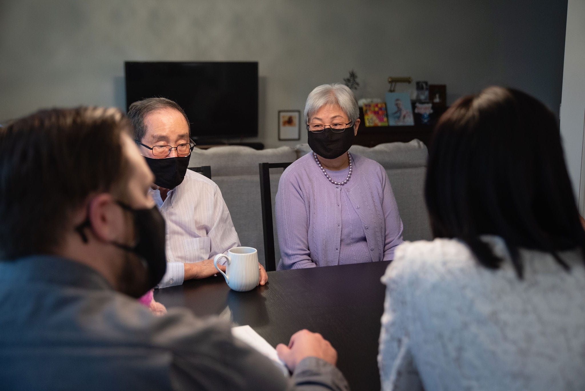 Older couple, masked, discussing their future choices