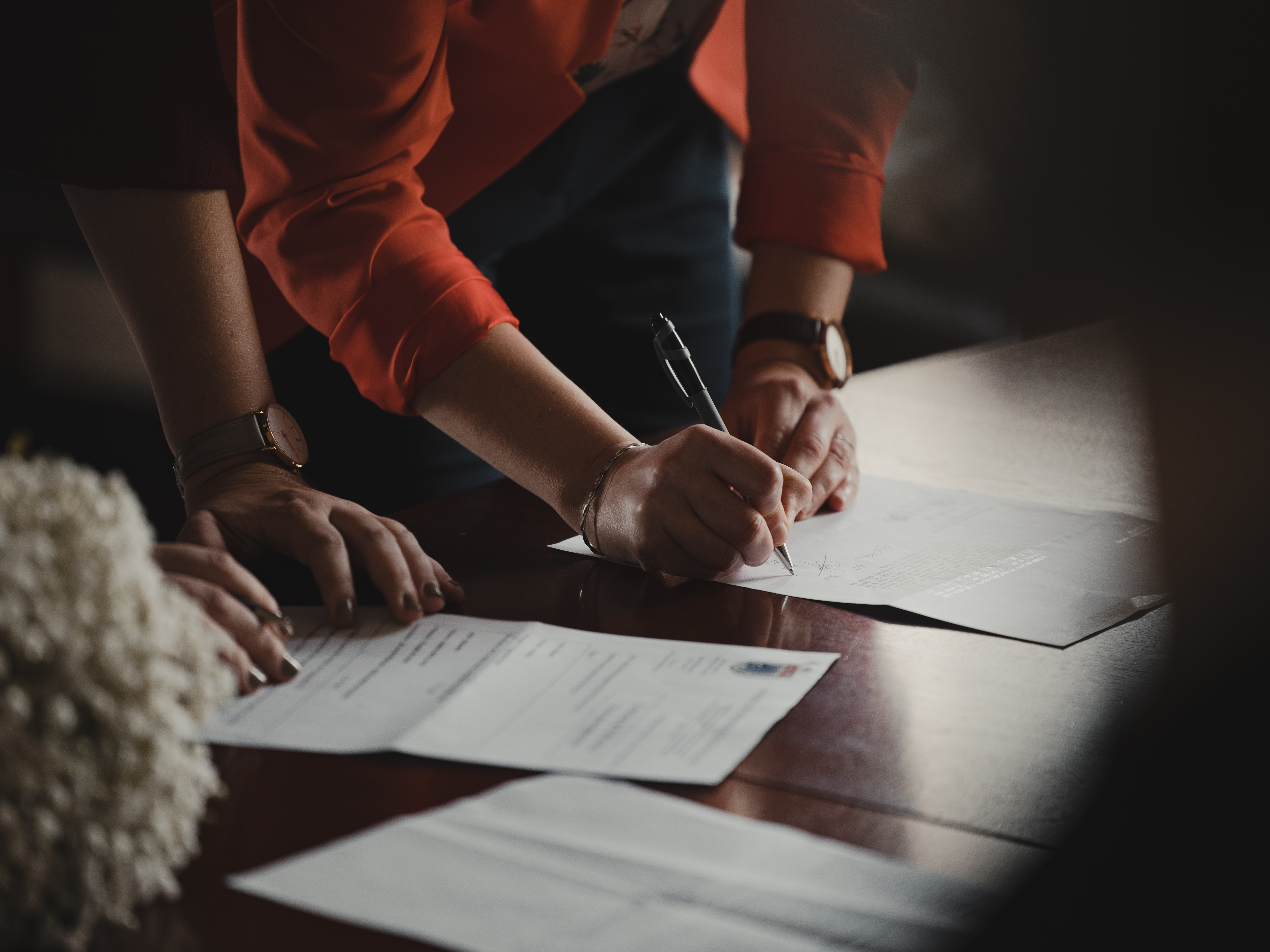 A woman signing a document