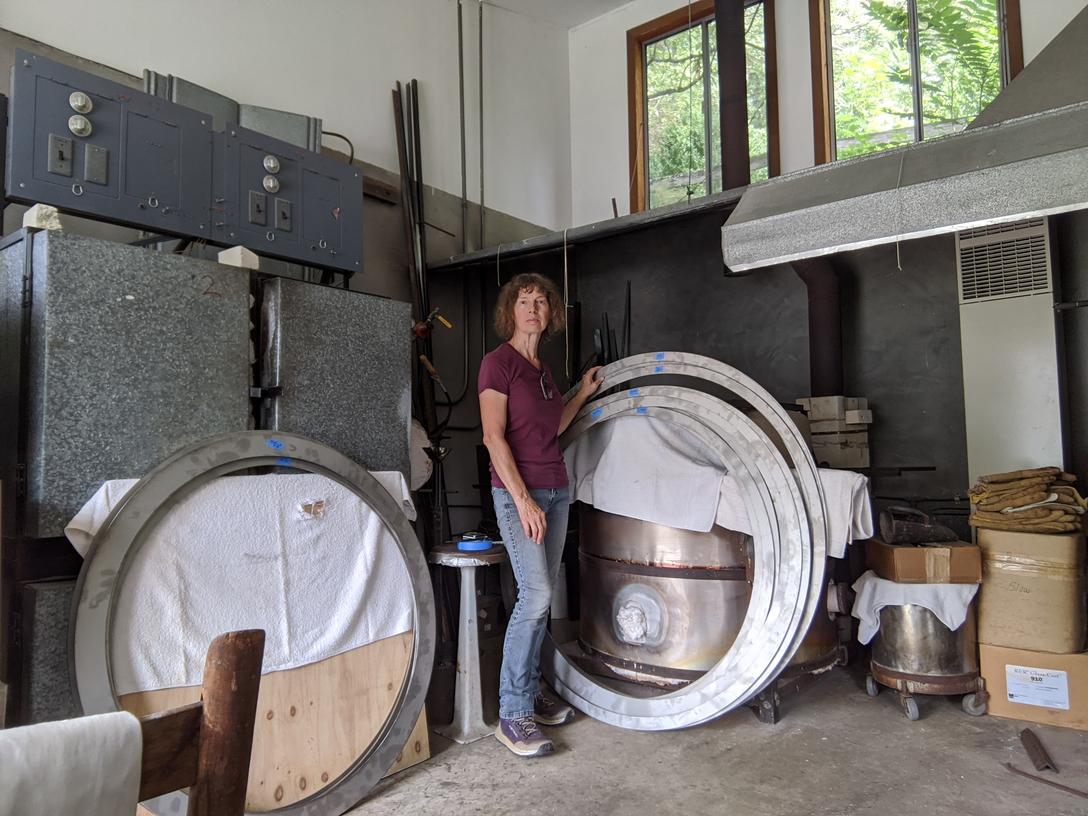 Steel hoops four to five feet in diameter in artist's work room.