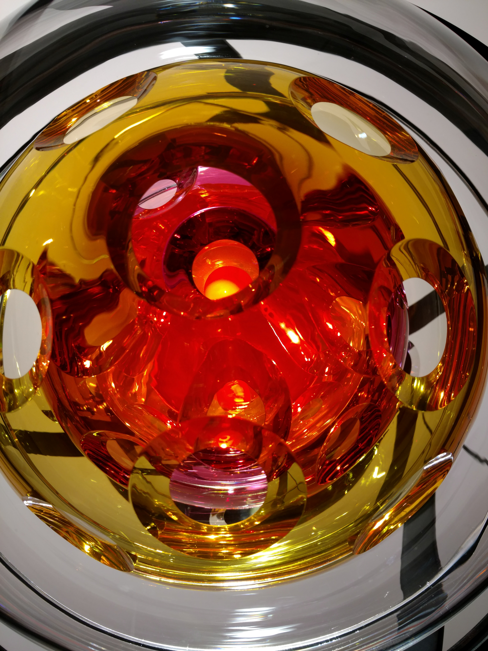 Close-up of glass sphere that spins in metal rings.