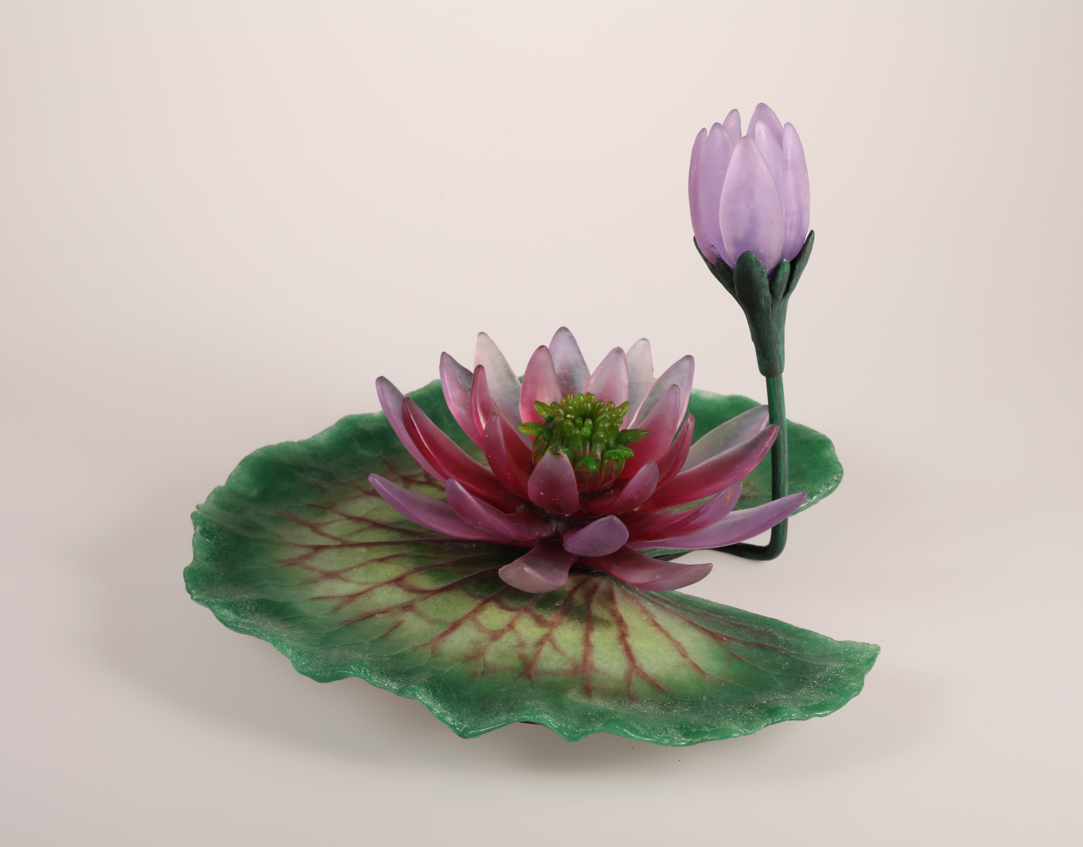 Glass water lily in ruby and green.