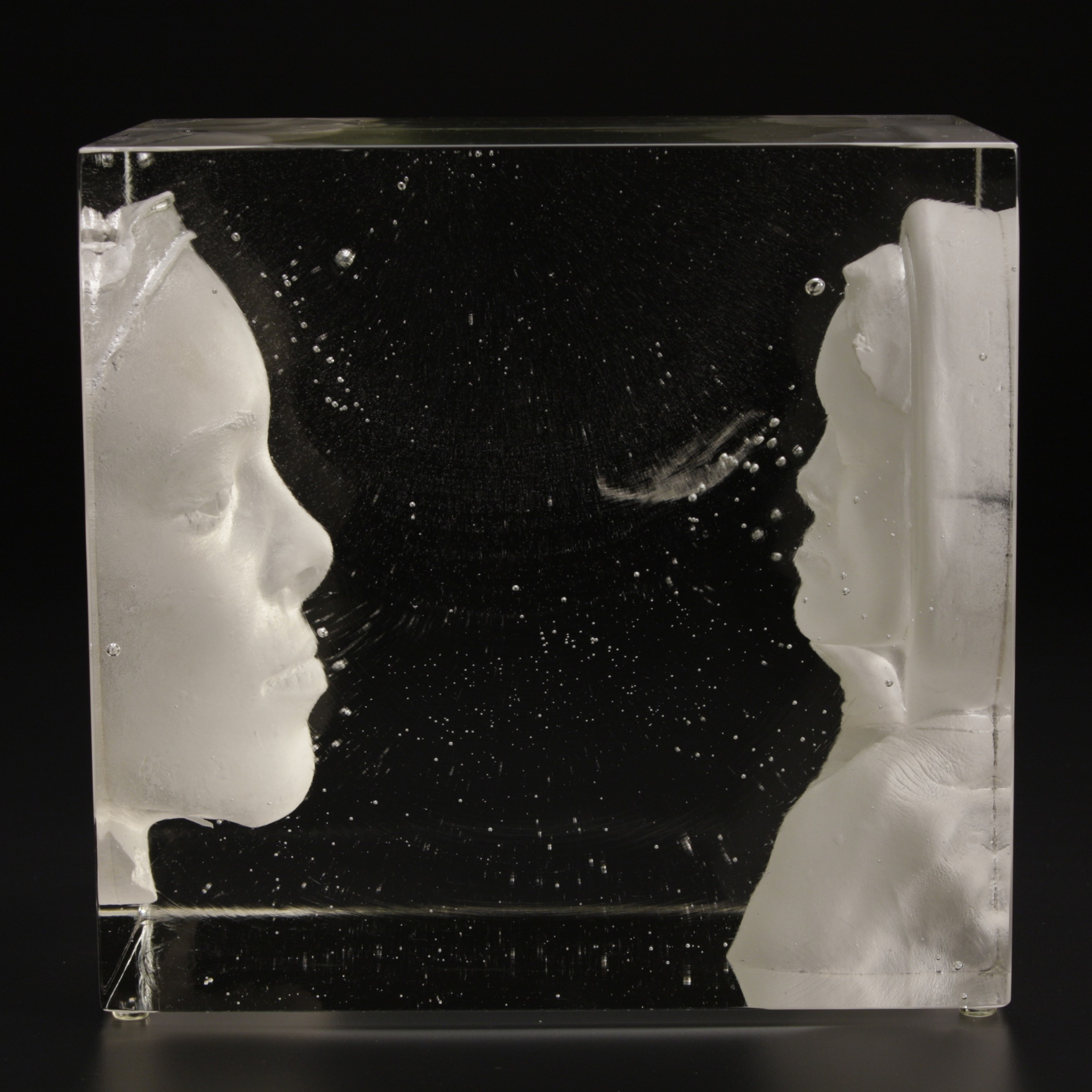 Cast glass block with face looking in the mirror.