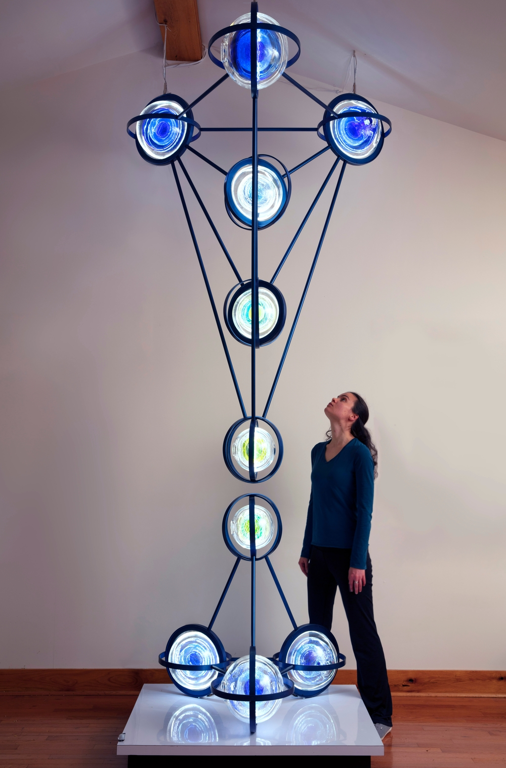 Sculpture of blown glass spheres, steel, and programmed LED lights.