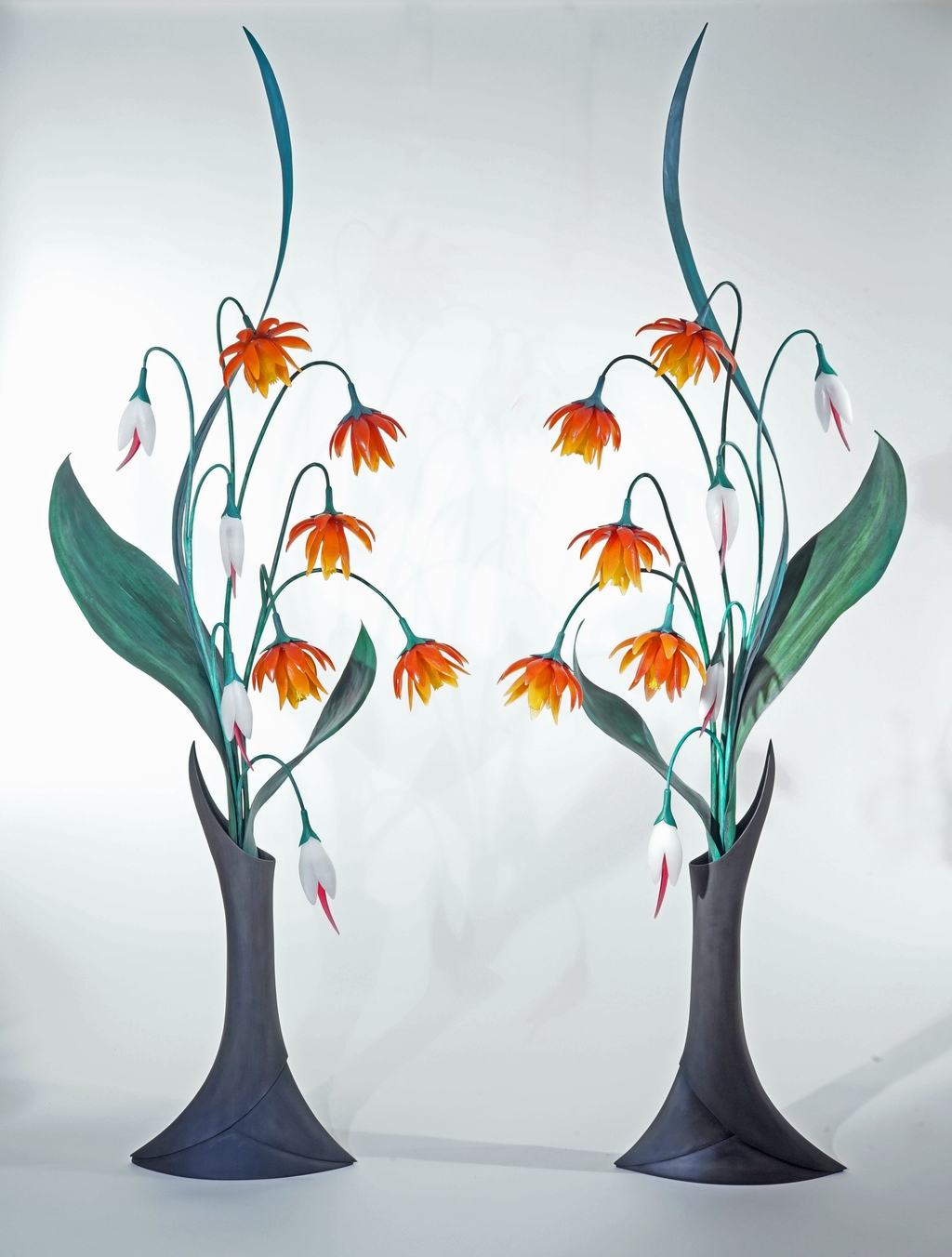 Sculpture of two seven and a half feet tall glass and steel flower arrangements.