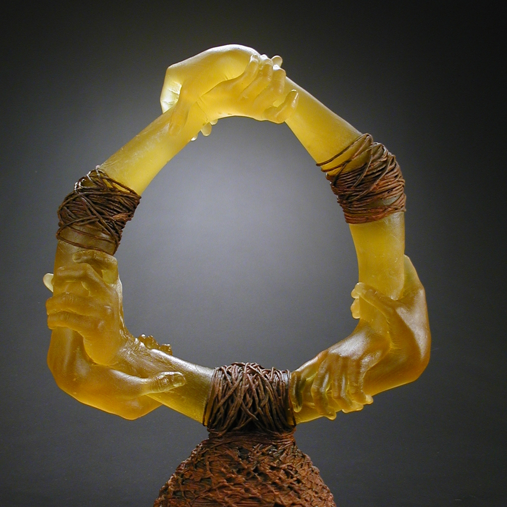 Three double set of cast glass hands bound together with rope.