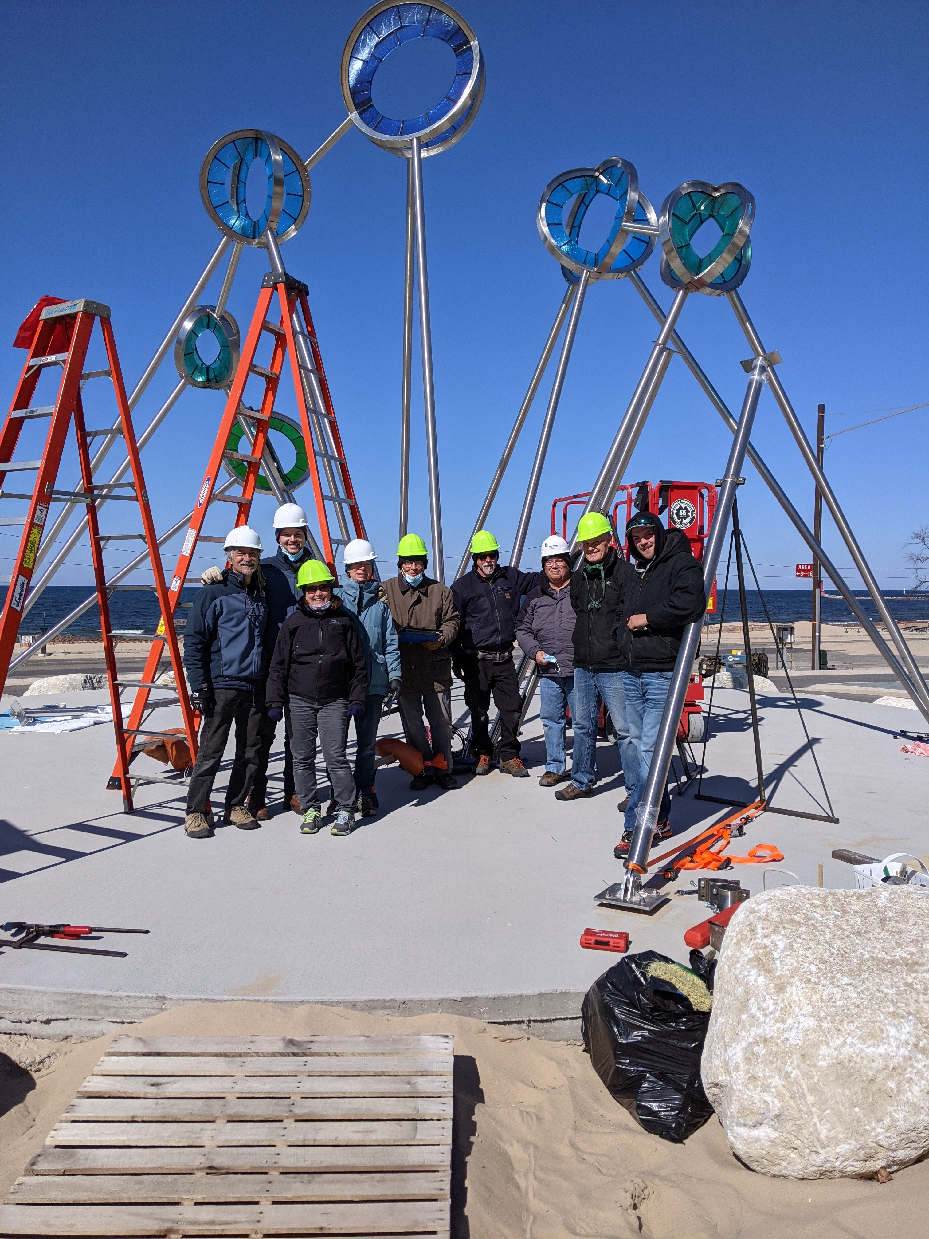 Install crew with sculpture in the background