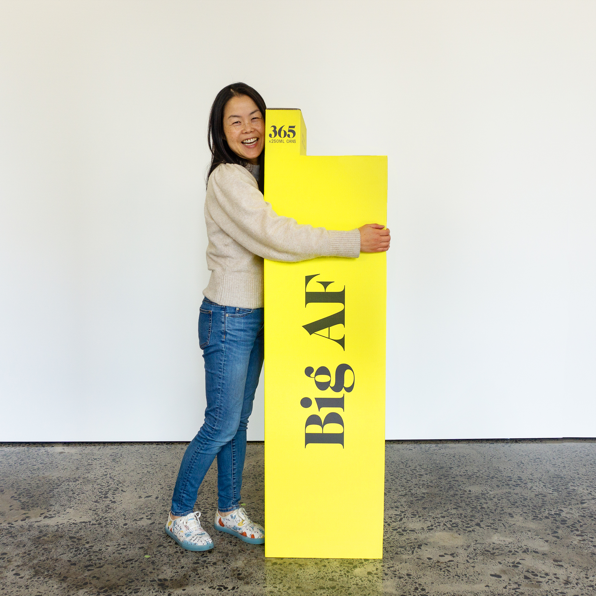 Lisa King standing with the AF BIG AF 365 Pack