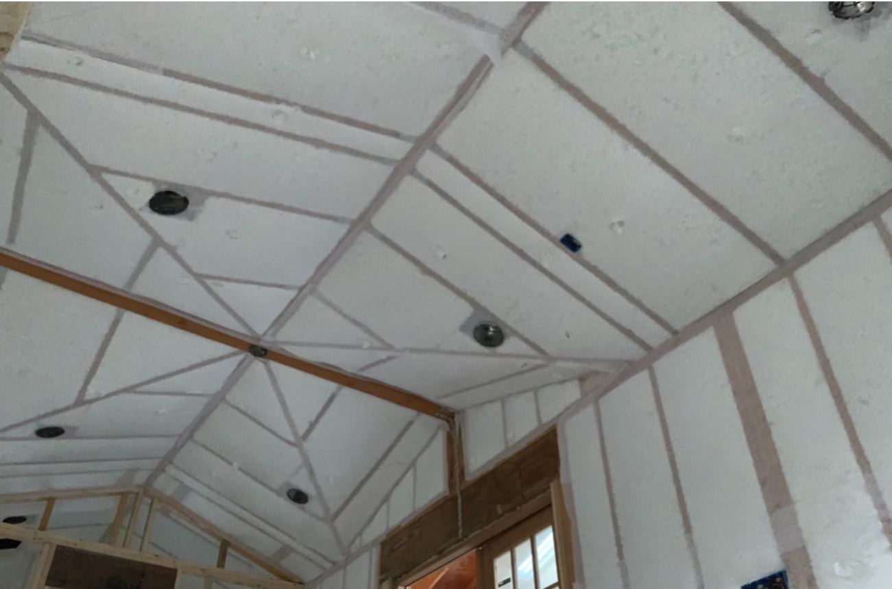 In this project a layer of spray foam is applied before installing BIBS insulation. This combination is one of the most effective methods of home insulation.