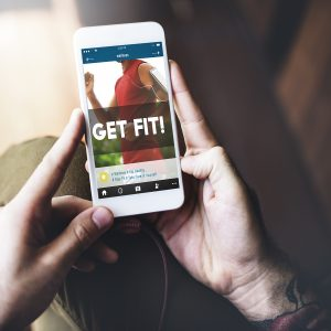 Man holding mobile with fitness app