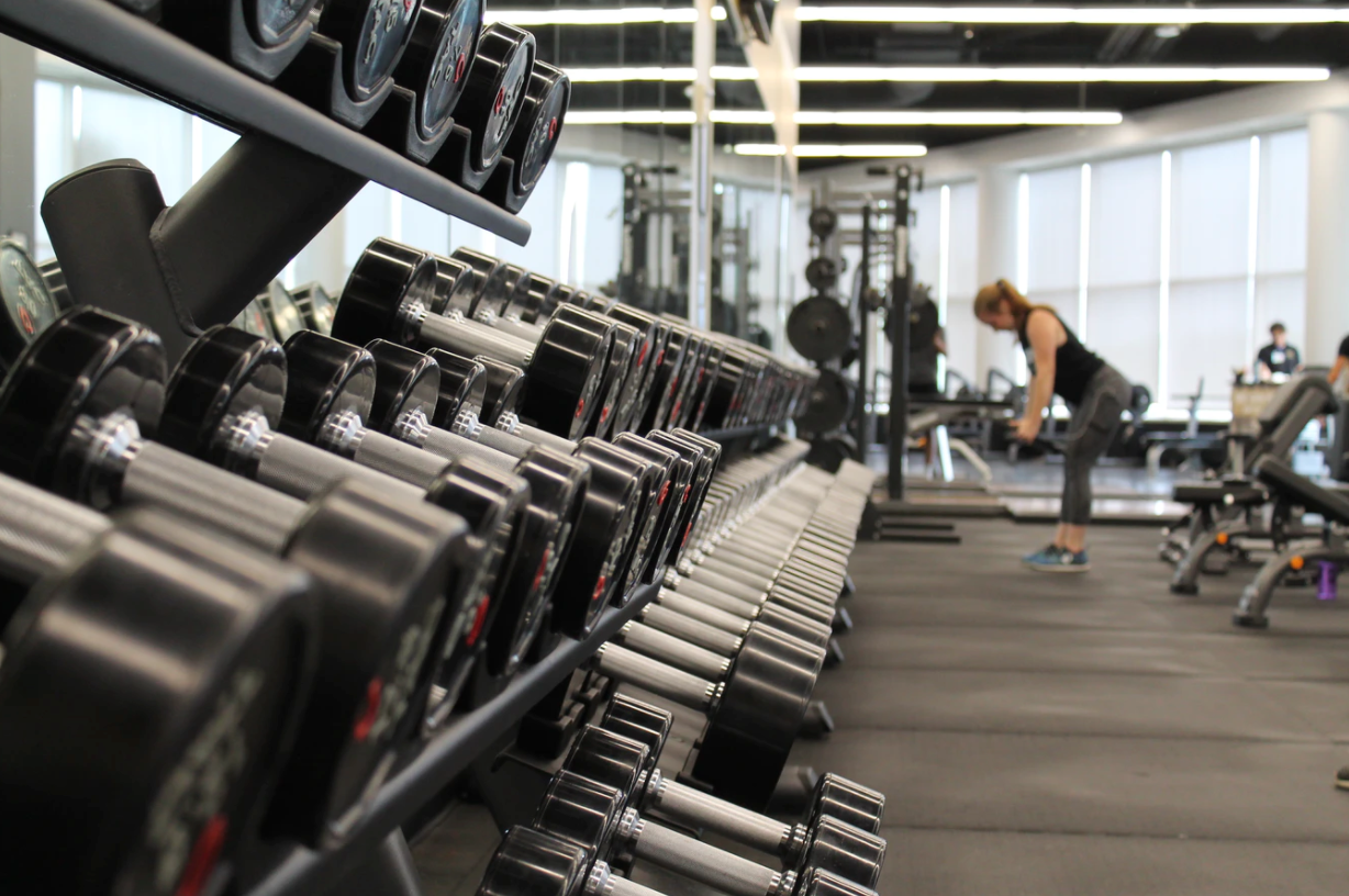A person working out in a gymDescription automatically generated with medium confidence