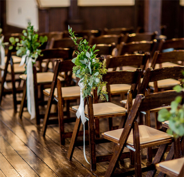 all-saints-chapel-flowers-on-chairs