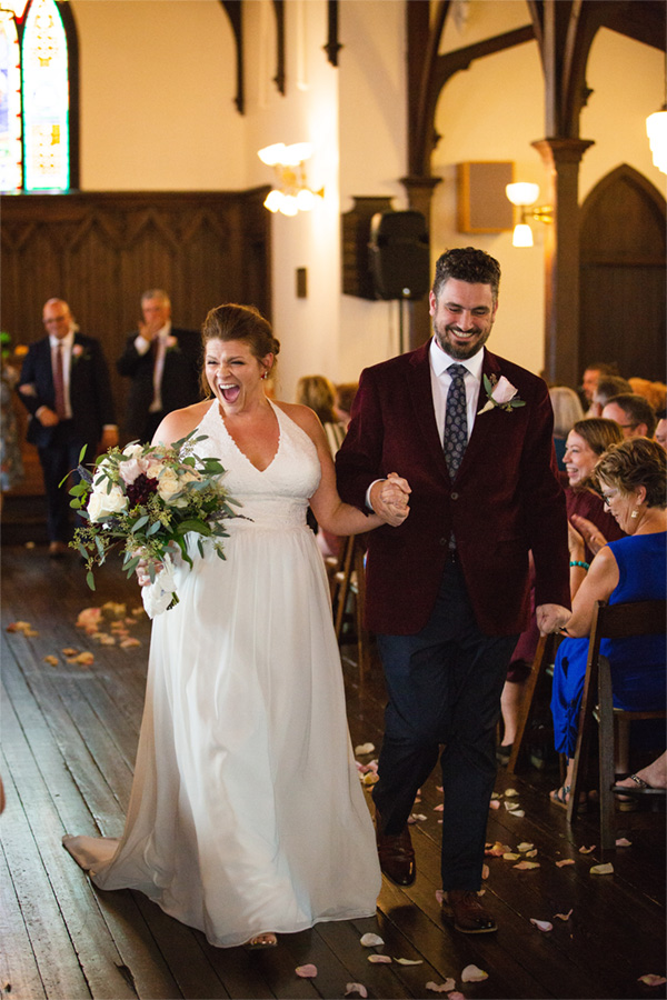 all-saints-chapel-couple-walk-down-aisle