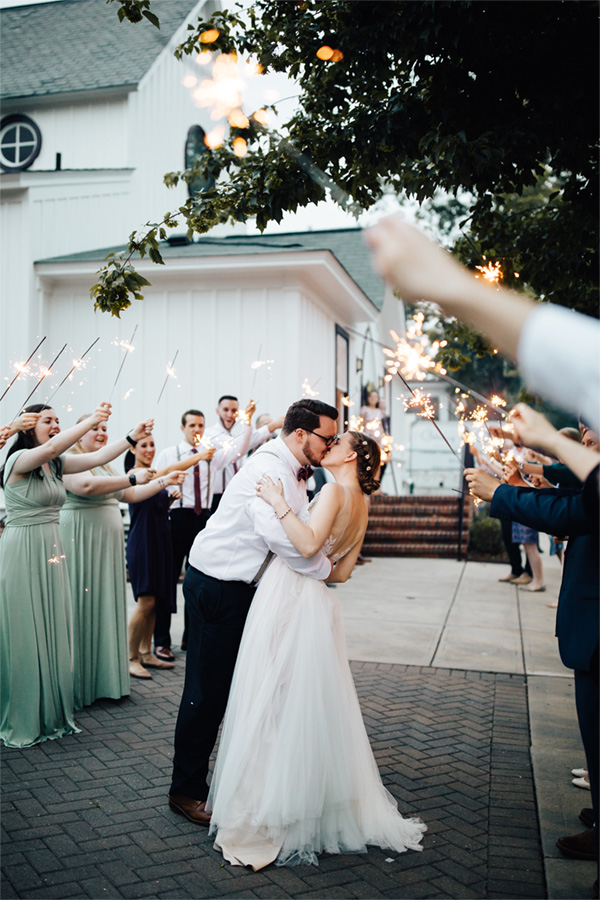 all-saints-chapel-couple-kiss-amid-sparklers