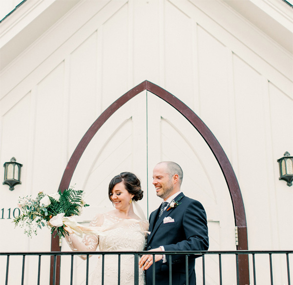 all-saints-chapel-couple-in-front-of-door
