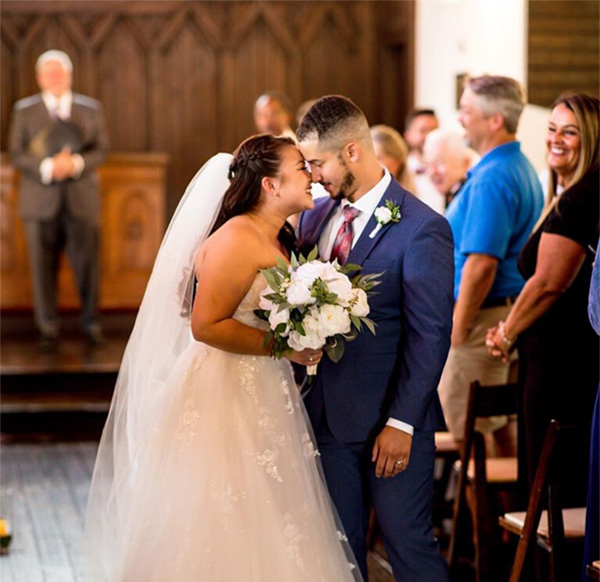 all-saints-chapel-couple-kiss-in-aisle