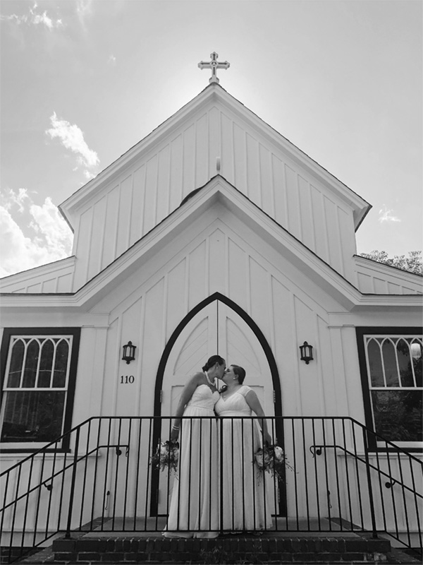 all-saints-chapel-brides-kiss-on-stairs