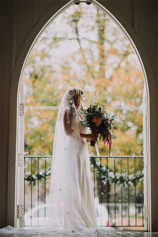 all-saints-chapel-bride-silhouetted-in-door-frame