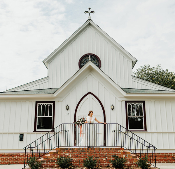 all-saints-chapel-bride-on-front-steps