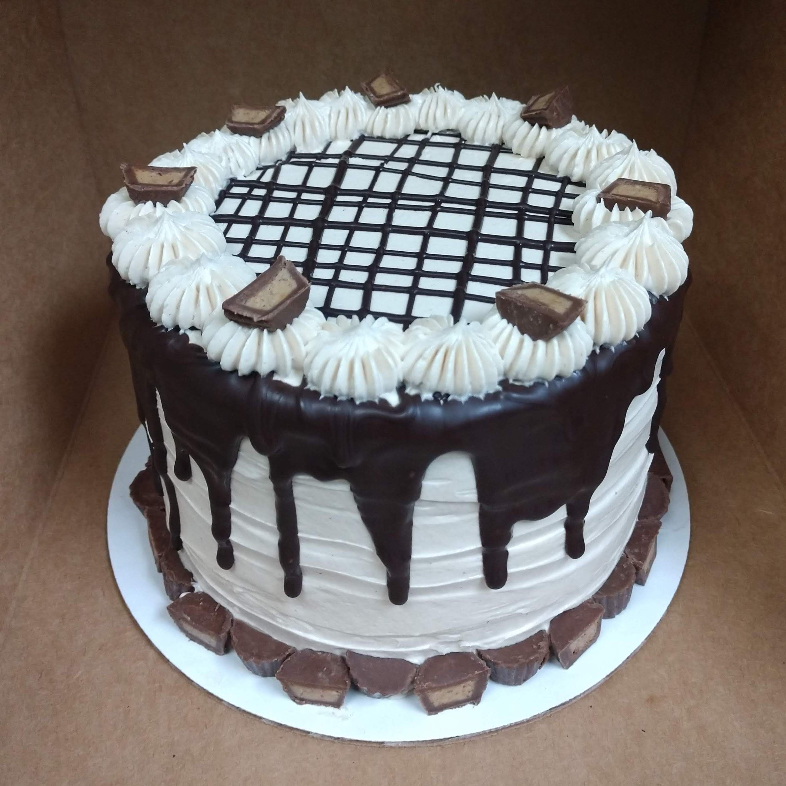 6in cake with vanilla buttercream, choc. drizzle and reese's cups