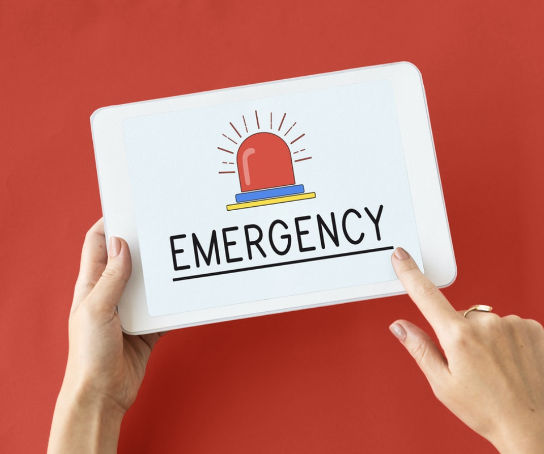 Emergency on red background