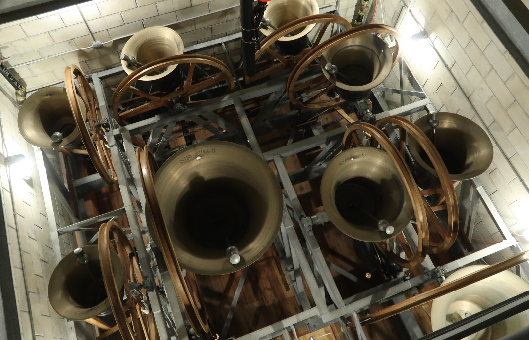 A view of bells in a belfry from above, mouths up, ready to ring.