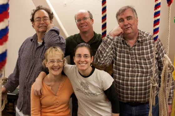 Five ringers, three men and two women, ranging in age from 20s to 60s, smiling.
