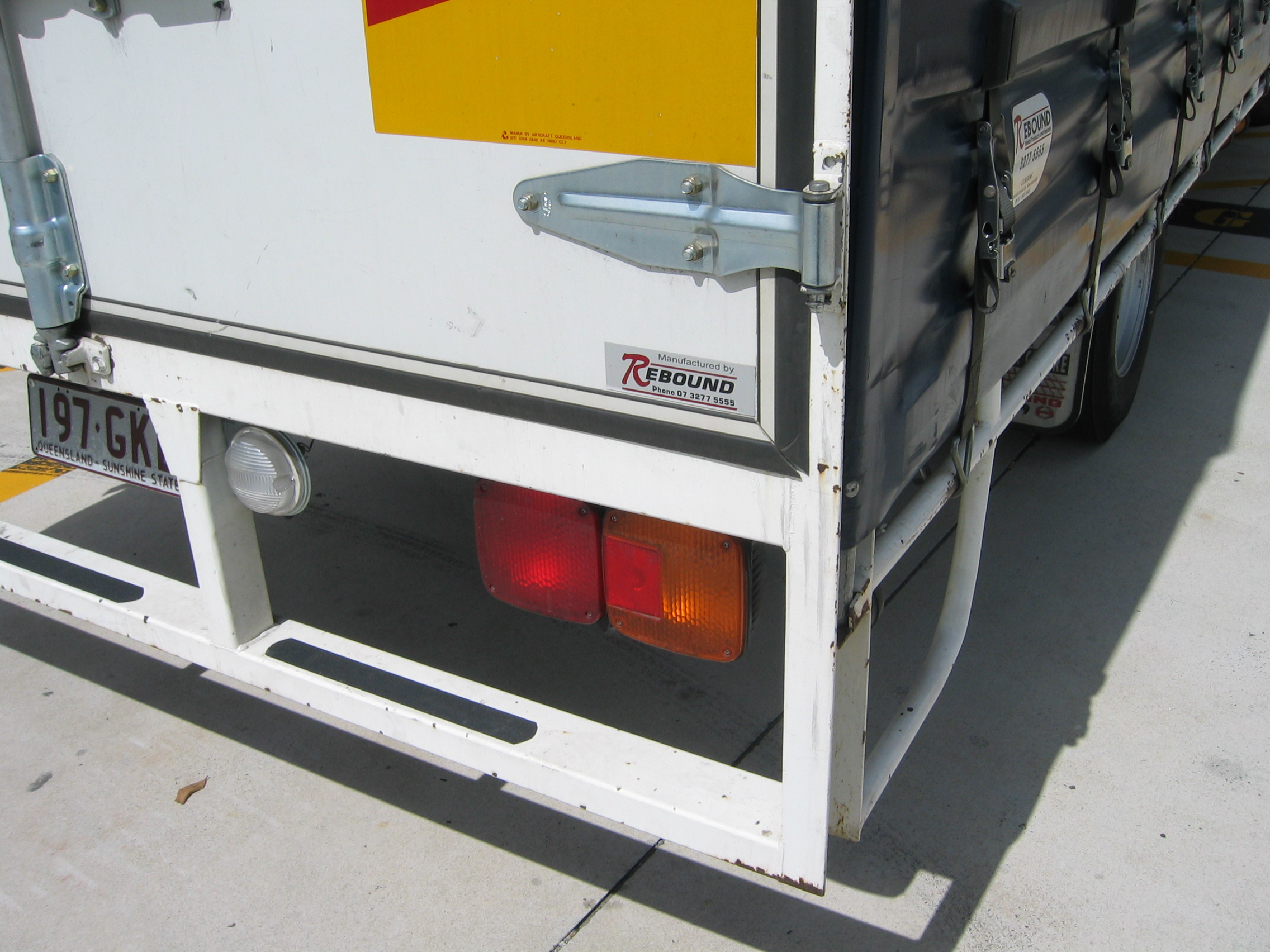 Product Nameplate on rear of a truck.