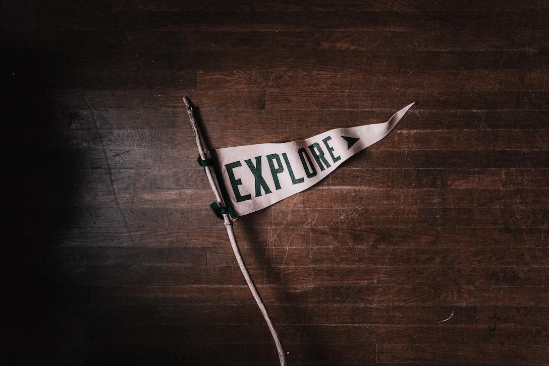 Explore Sign Photo by Andrew Neel on Unsplash