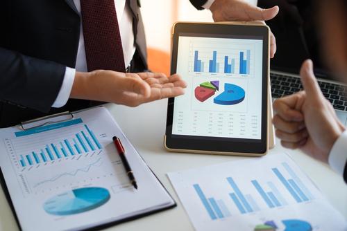 man-showing-sales-data