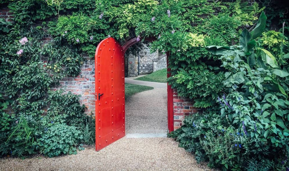 Open deal door revealing winding path