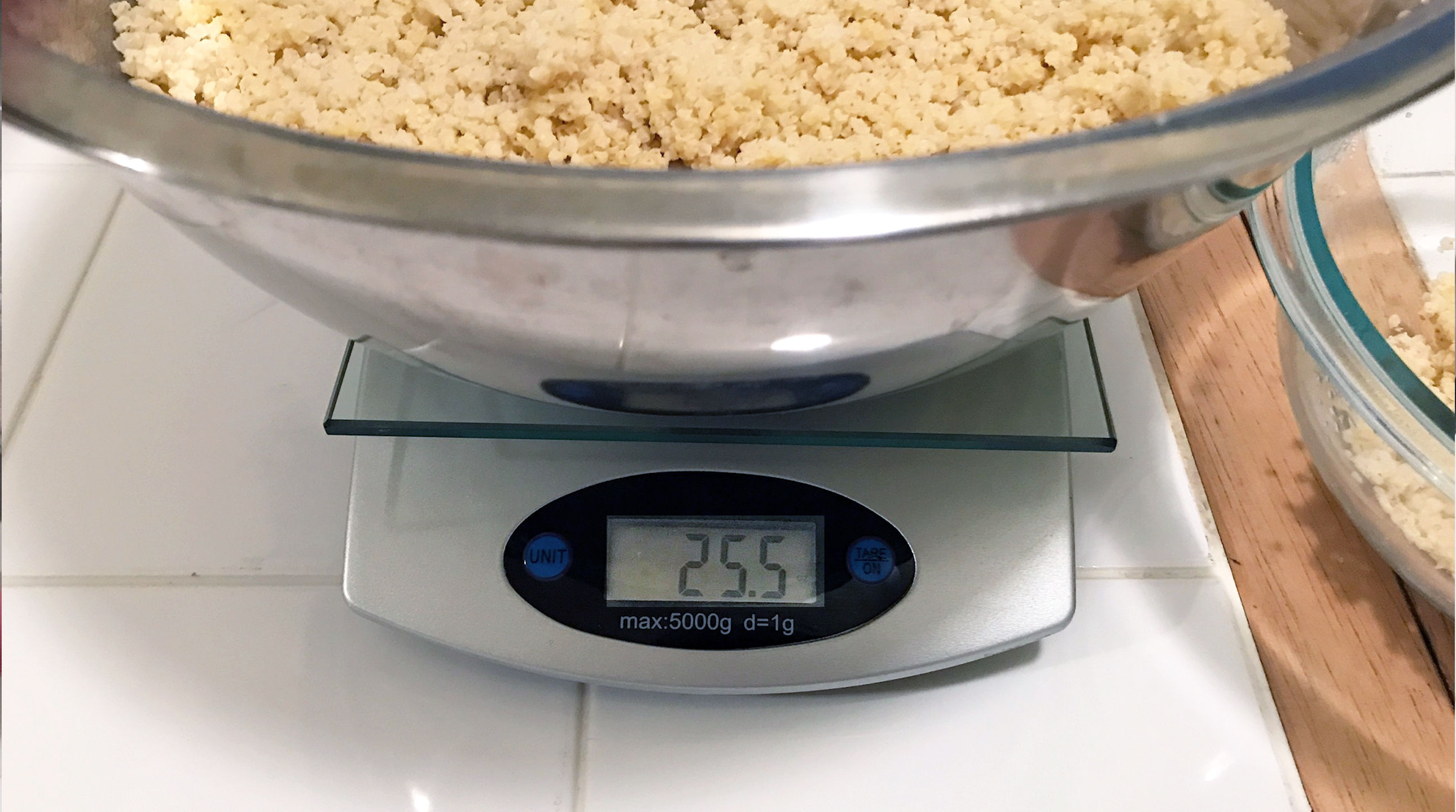 Cooked meat being weighed on a food scale